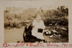 "1910, Burdell & Loretta Hobbs."" [ 3 buildings/houses in the background]"