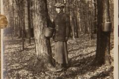 "1910, ""Easel Bilky Barrick, 1910, Ohio"", [label on back]: ""Easel Bilkey Barrick on farm at sugar bush, gathering maple sap"""