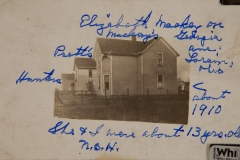 """1910, Elizabeth Mackey [to the right of house], Georgia ave, Lorain Ohio, She & I [Nellie B Harnish] we about 13 yrs. old.[second house is the """"Pratt's"""" and third is the Hunters"""""""